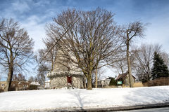 Old windmill. In Lachine Quebec on a cold winter day with a blue sky royalty free stock photography