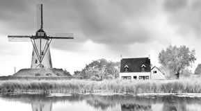 Old windmill landscape canal mill clouds stock image