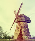 Old windmill, Latvia, Europe. Cesis region is beauty spot in Latvia where medieval history meets with marvelous scenic landscapes. Image slightly toned for Stock Photo