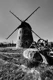 Old windmill in the light of the setting sun. Stock Photos