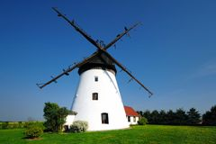 Old windmill in the light of the setting sun. Royalty Free Stock Photos