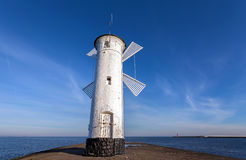 Old windmill lighthouse in Swinoujscie, Poland Stock Photo