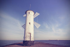 Old windmill lighthouse in Swinoujscie, Poland. Royalty Free Stock Photography
