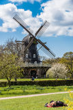 Old Windmill. In Malmo Royal park (Kungsparken) with people enjoying the warm spring day Stock Image