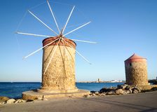 Old windmill in Mandraki port of Rhodes. stock photography