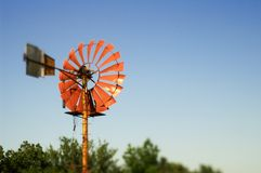 Old windmill. With metal vanes against clear blue sky Royalty Free Stock Photos