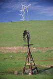 Old windmill with new windmills Royalty Free Stock Image