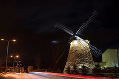 Old windmill at night with moon Stock Image