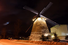 Old windmill at night with moon Stock Photography