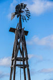 Old windmill in Oklahoma. With blue sky and clouds in background Royalty Free Stock Image