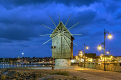Old windmill in Old Town of Nessebar in evening, Bulgaria Stock Photo