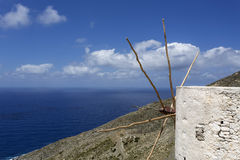 Old windmill overlooking the sea on Karpathos, Greece Stock Photography