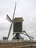 Old windmill and pierl in Heusden. Royalty Free Stock Image