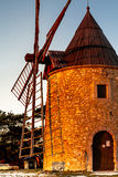 Old windmill in Provence, France. Shot in a quiet morning Royalty Free Stock Photo