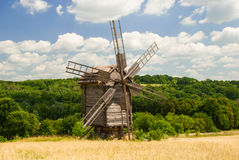 An old windmill, Pyrohiv, Ukraine. An old windmill under the bright summer sun, National Museum of Folk Architecture and Life of Ukraine Royalty Free Stock Photography