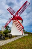 Old windmill Red Peak Mill in Bretanha (Sao Miguel, Azores). Traditional white wind mill with red roof and wings in village