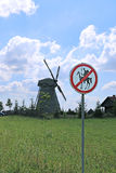 Old windmill and road sign to Don Quixote passage banned in Dudutki Stock Photo