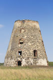 The old windmill ruins. On a blue sky background Stock Photography