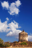 Old windmill ruins on a hill in Santorini island Stock Photos