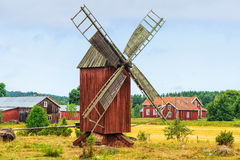Old windmill in a rural landscape. Old red windmill in a rural landscape. From the island Ã…land, Finland royalty free stock images