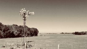 Old windmill Woodside, Victoria, Australia. Old windmill set on a farm out in Woodside Gippsland Victoria Australia. Done in Black and while stock image