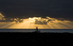 Old windmill silhouette at sunrise Royalty Free Stock Photos