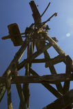 Old windmill silhouetted against the blue sky Royalty Free Stock Photos