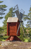 Old windmill on a small hill Stock Photos