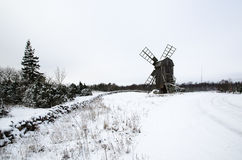 Old windmill in a snowy landscape Stock Photo