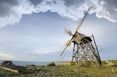 Old windmill on stoney beach Royalty Free Stock Photography