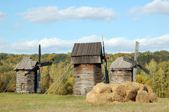 Old windmill and straw roll. Antique wooden windmill and straw roll, Pirogovo, Kiev, Ukraine Royalty Free Stock Photos