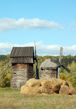 Old windmill and straw roll. Antique wooden windmill and straw roll, Pirogovo, Kiev, Ukraine Royalty Free Stock Image