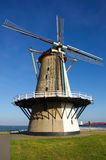 Old windmill in the Sun in Holland. Old windmill in Vlissingen at the Scheldt estuary stock photo