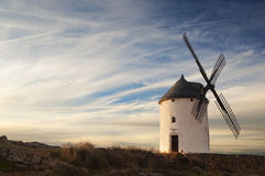 Old windmill at the sunset. In Consuegra, Spain Royalty Free Stock Photos