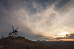 Old windmill at the sunset. Old windmills at the sunset in Consuegra, Spain Royalty Free Stock Photo