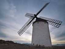 Old windmill at sunset  in Consuegra. Old windmill at sunset with cloudy sky in Consuegra Royalty Free Stock Photos