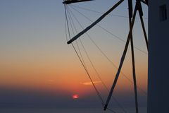 Old windmill at sunset in Oia, Santorini, Greece. Royalty Free Stock Image