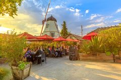 Old Windmill sunset in Solvang. Solvang, California, United States - August 10, 2018: people at a coffee shop enjoy picturesque Danish architecture of Solvang stock images