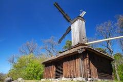 Old windmill under blue sky, Stockholm. Old wooden windmill under blue sky, rural Swedish landscape stock image