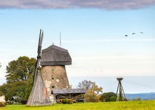 Old windmill in Vidzeme region of Latvia, Europe. Latvia is a small nice European country where medieval history meets with marvelous scenic landscapes and clean Royalty Free Stock Photo