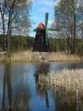 Old windmill was built as a tourist attraction built on the isla Stock Images