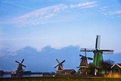 Old windmill in the winter. Village Zaanse Schans, Netherlands. Royalty Free Stock Images