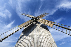 Old windmill. Old wooden windmill set against the sky Stock Photography