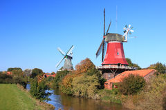 Old Windmills. Windmills in Greetsiel, East Frisia, Lower Saxony, Germany Royalty Free Stock Image