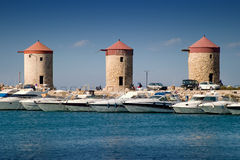 Old windmills. On the coast in Rhodes, Greece stock photo