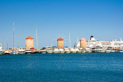 Old windmills in harbour of Rodes, Greece Royalty Free Stock Photos