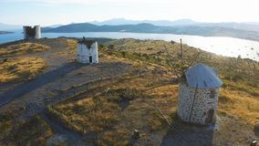 Old windmills on the hill in Bodrum, Turkey. Spectacular landscape at sunset. Welcome to Turkey concept stock video