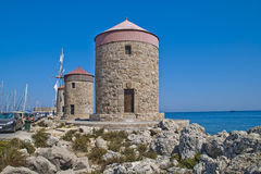 Old windmills at mandraki harbor (rhodes) Royalty Free Stock Image