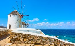 Windmills on the seashore in Mykonos Royalty Free Stock Image