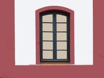 Old window. On a whait building Stock Photos